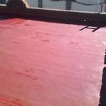 Elastomeric emulsion over wood roof