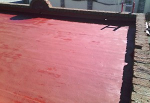 Elastomeric emulsion over wood roof